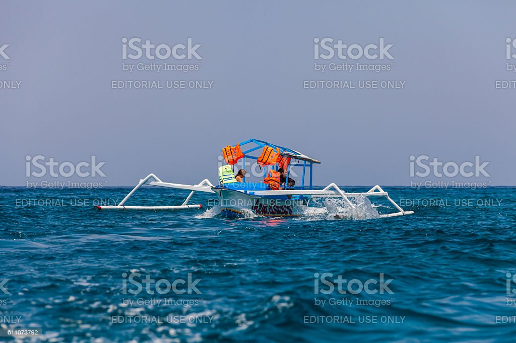 Boat by the Gili Islands in Lombok, Indonesia stock photo