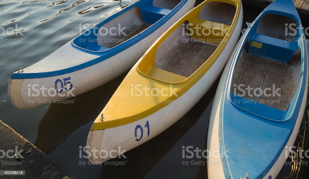 boat canoe in the water stock photo