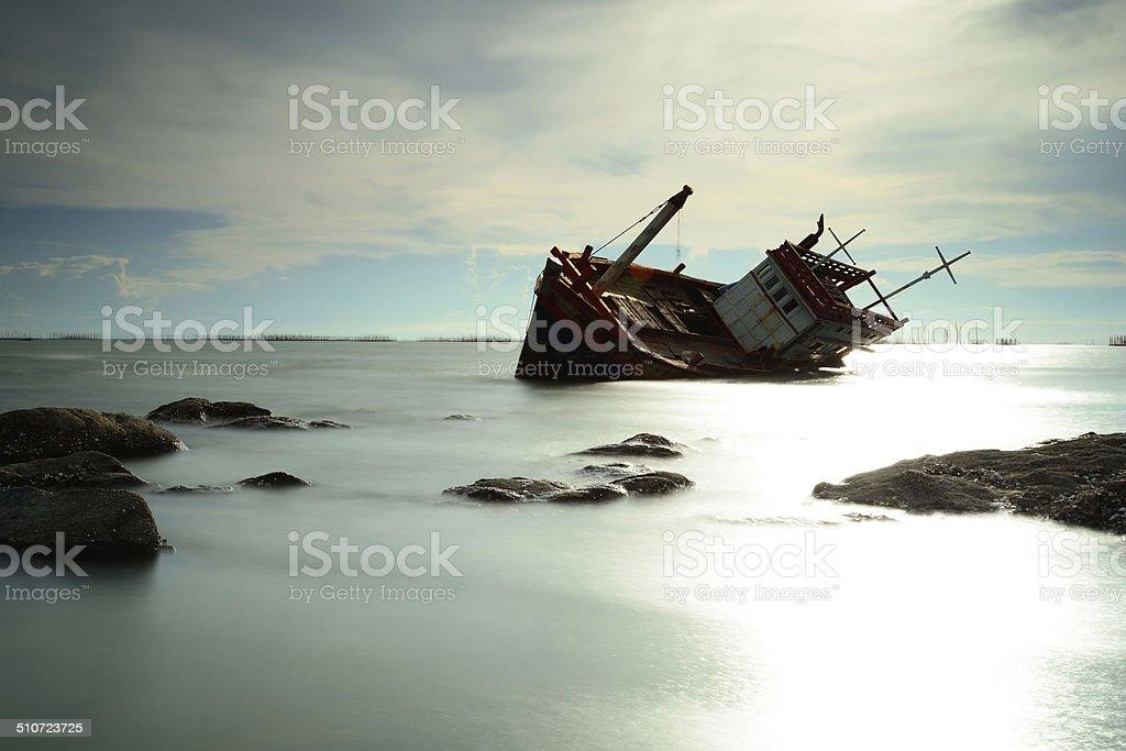 Boat capsized stock photo