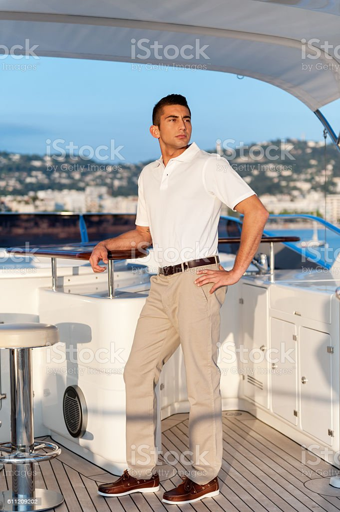 Boat captain standing on yacht stock photo