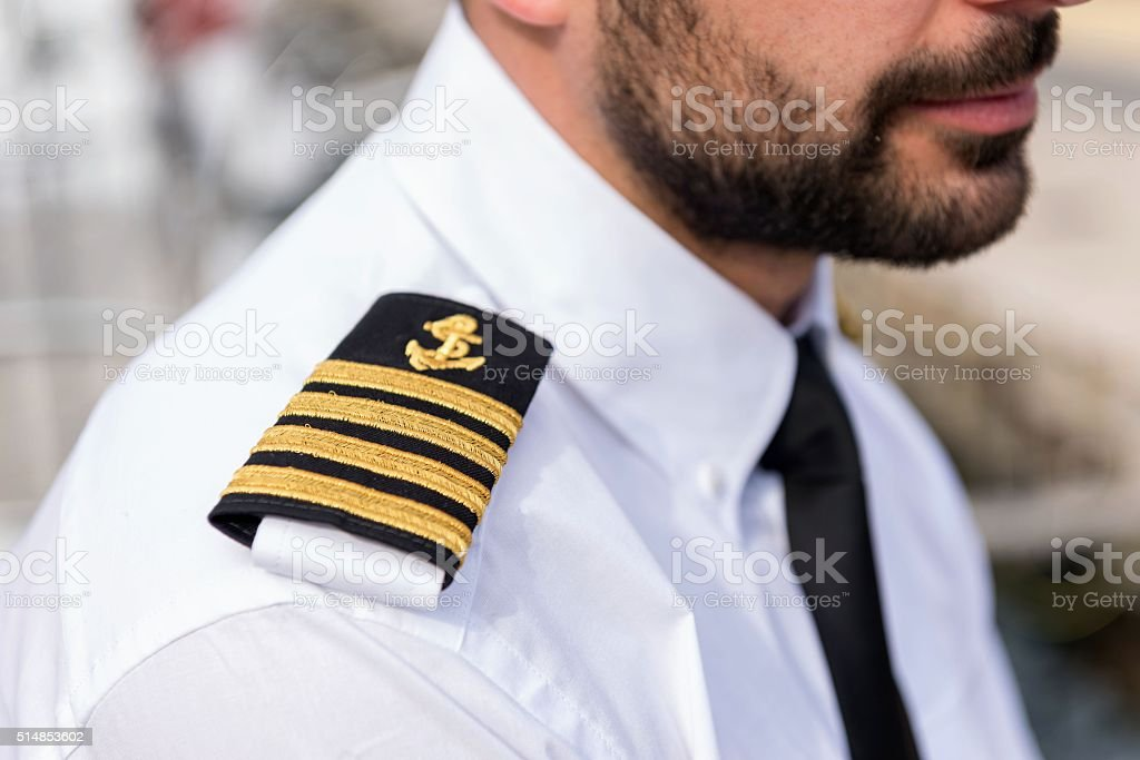 Boat captain with shoulder epaulette stock photo