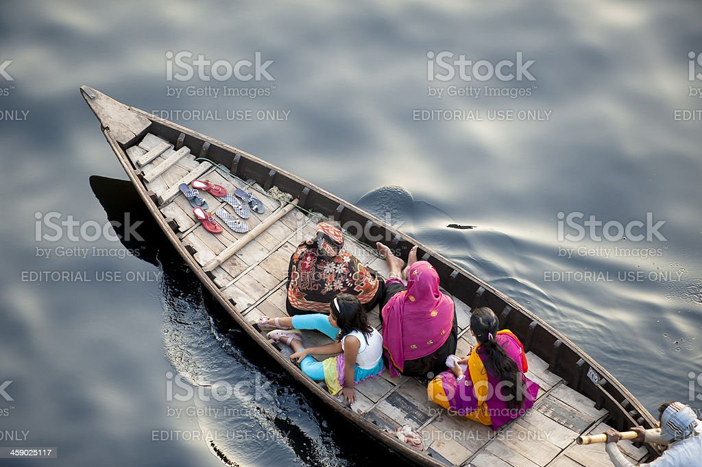 Boat carrying Bengalese on black water, Dhaka, Bangladesh stock photo