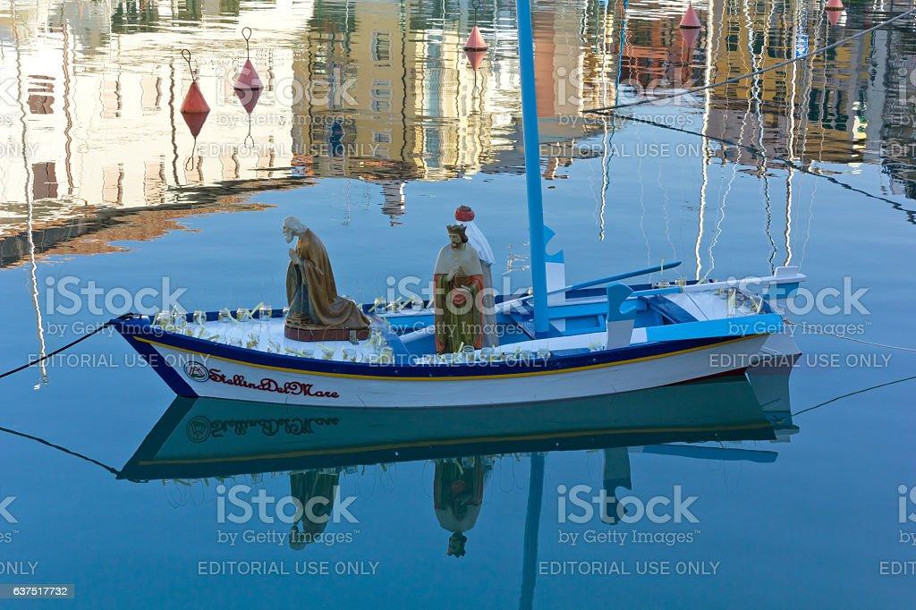 Boat Carrying the Three Magi in the Floating Nativity Scene stock photo