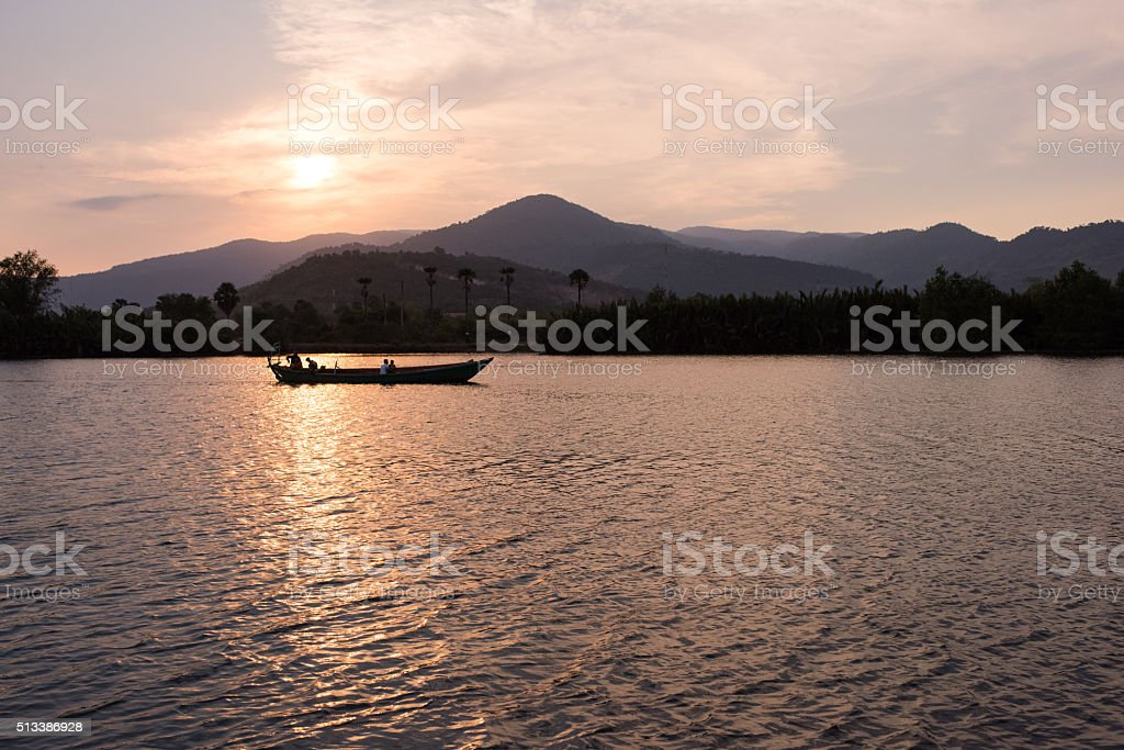Boat caught in sunlight on the Kampot (Cambodia) river stock photo