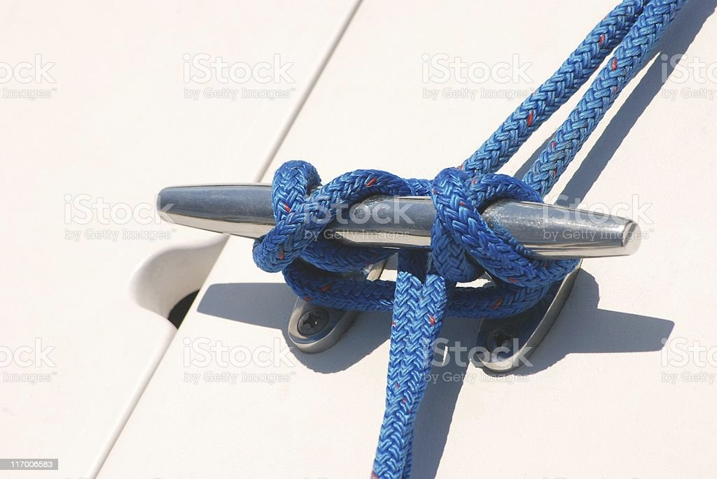 Boat cleat & blue rope royalty-free stock photo