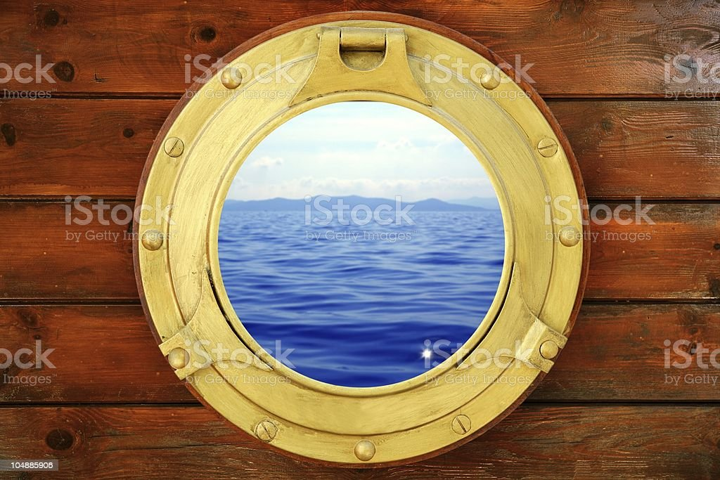 Boat closed porthole with vacation seascape view stock photo
