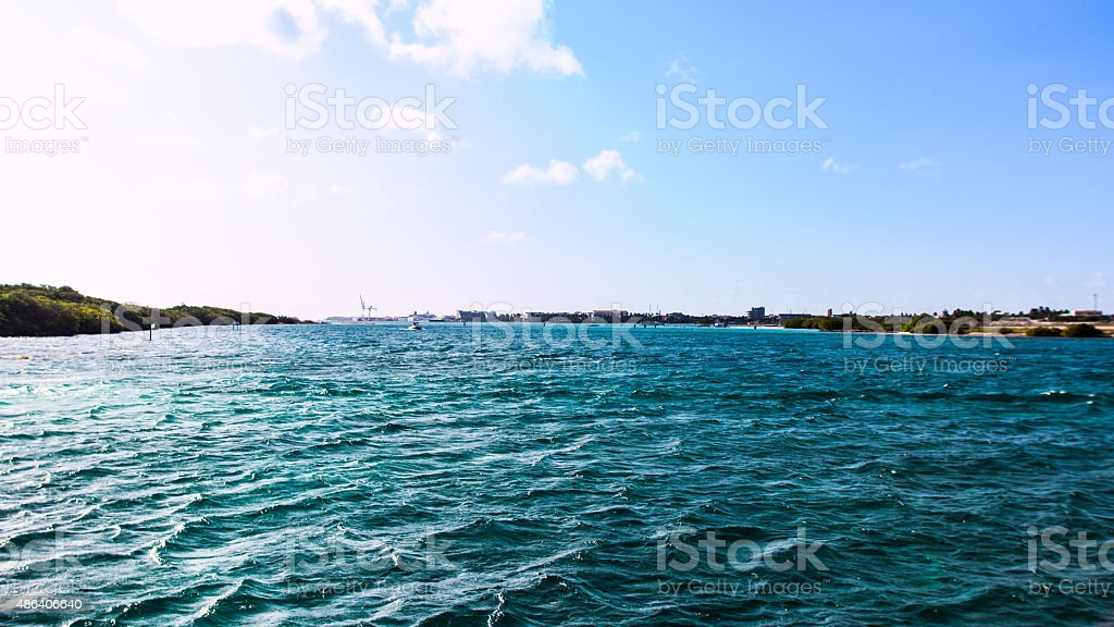 Boat coming in on Bluewater stock photo