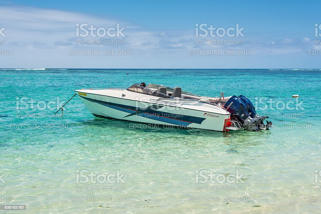 Boat crew waiting for the tourists at the beach stock photo