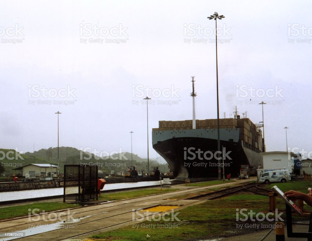 boat crossing the panama channel from behind stock photo
