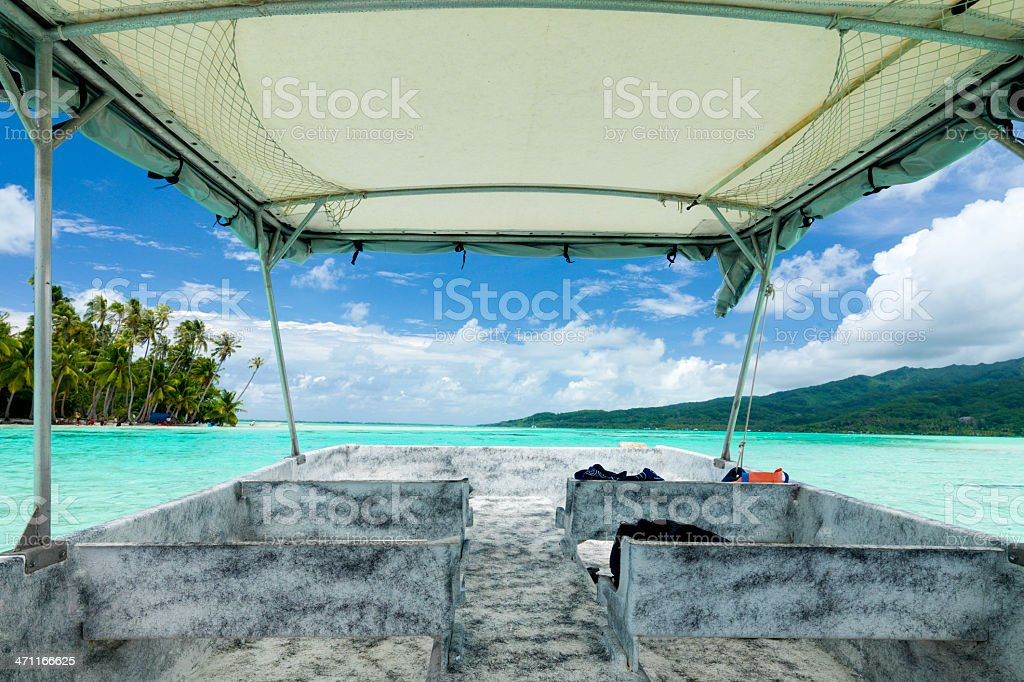 Boat cruising in tropical lagoon royalty-free stock photo