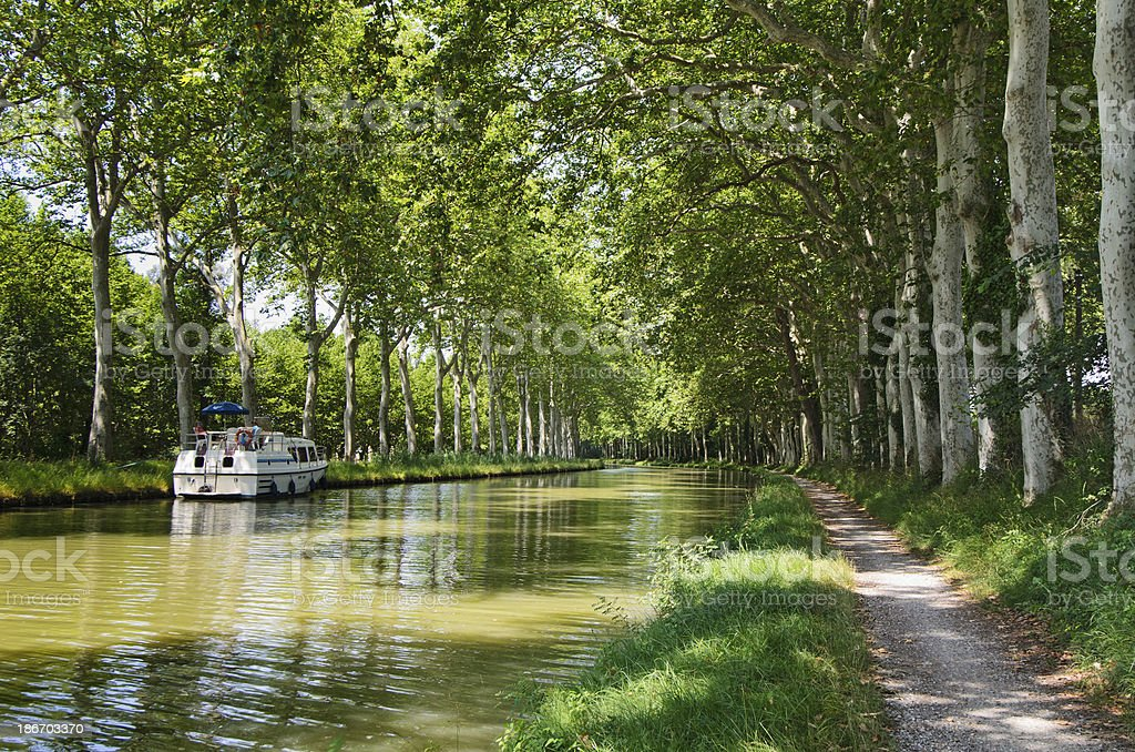 Boat cruising on the Canal Du Midi, France stock photo