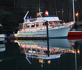 Boat Decorated With Lights For Christmas