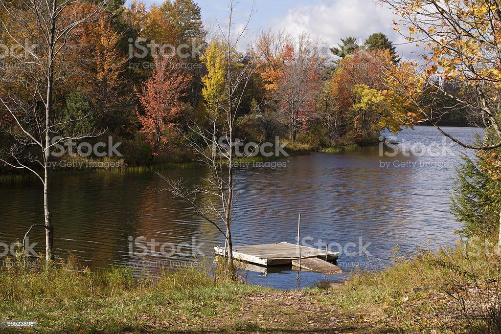 Boat Dock in Lake during Fall Season stock photo