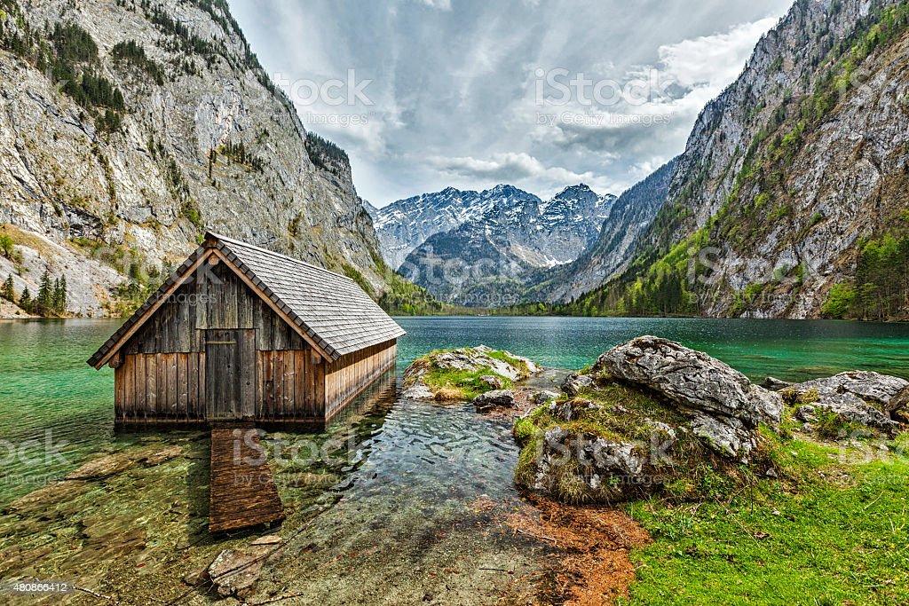 Boat dock on Obersee lake. Bavaria, Germany stock photo
