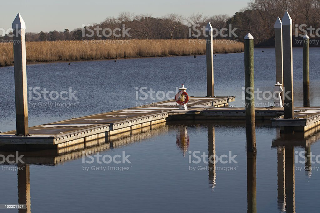 Boat Dock on River with Reflection royalty-free stock photo