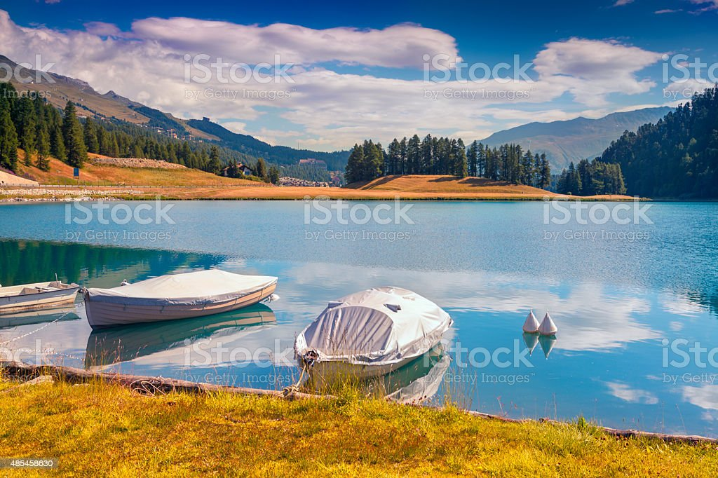 Boat dock on the lake Champfer lake in Swiss Alps. stock photo