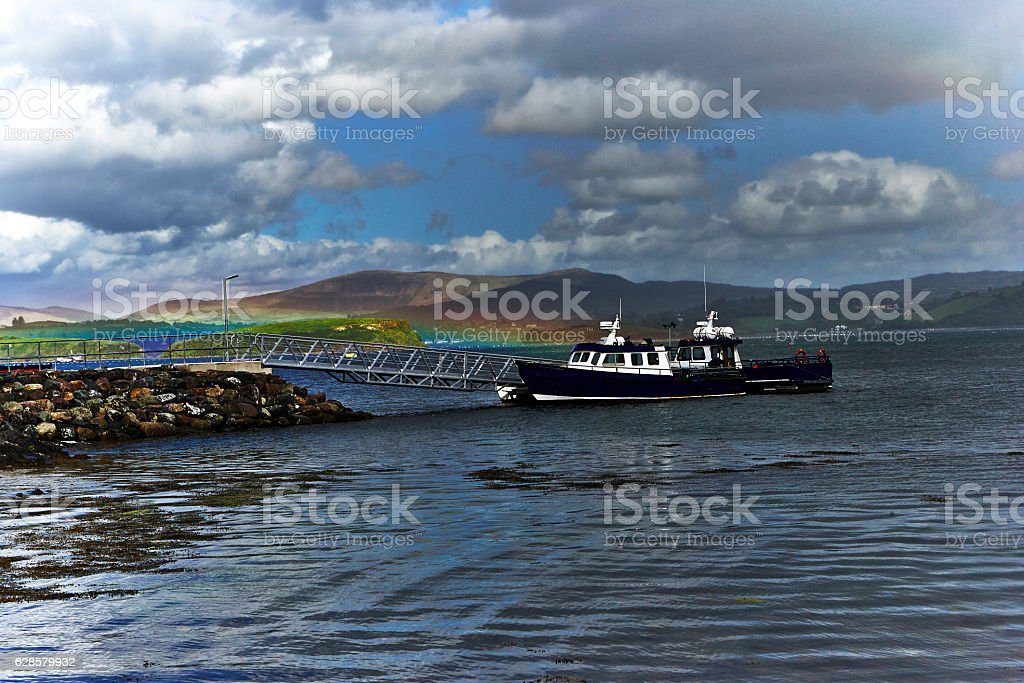 Boat Dock with Rainbow at Whiddy Island, Bantry Bay Ireland stock photo