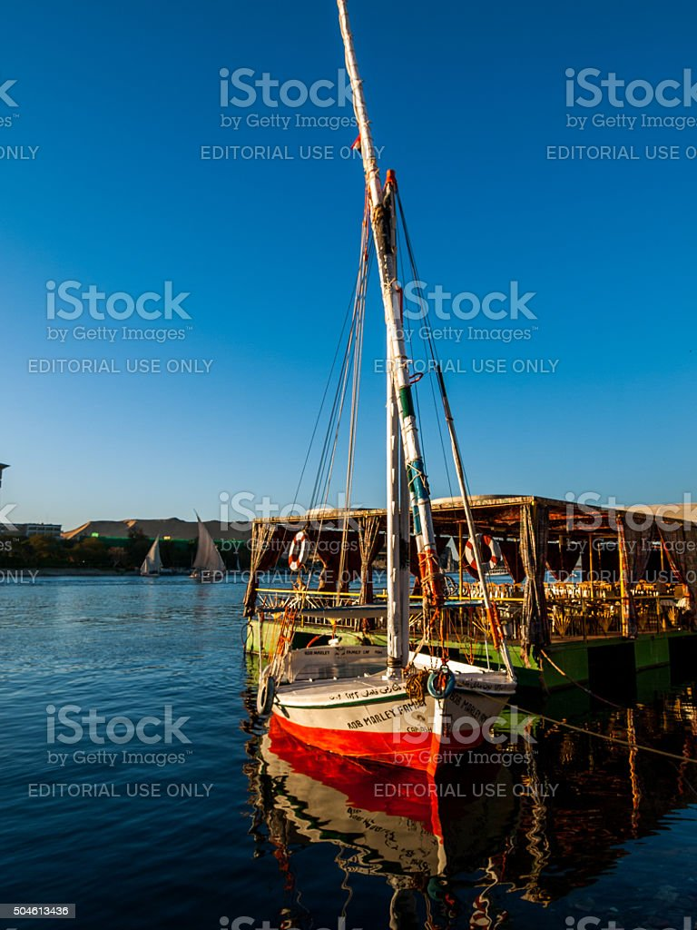 Boat docked by the river in Aswan, Egypt stock photo