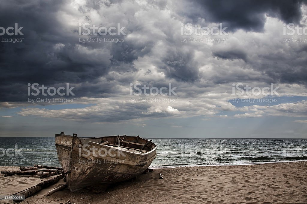 Boat docked on the sand at the ocean stock photo
