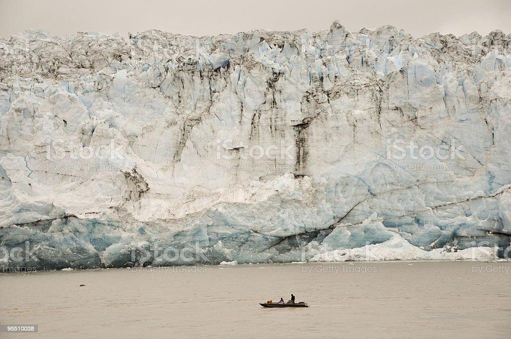 boat dwarfed by Child's Glacier stock photo