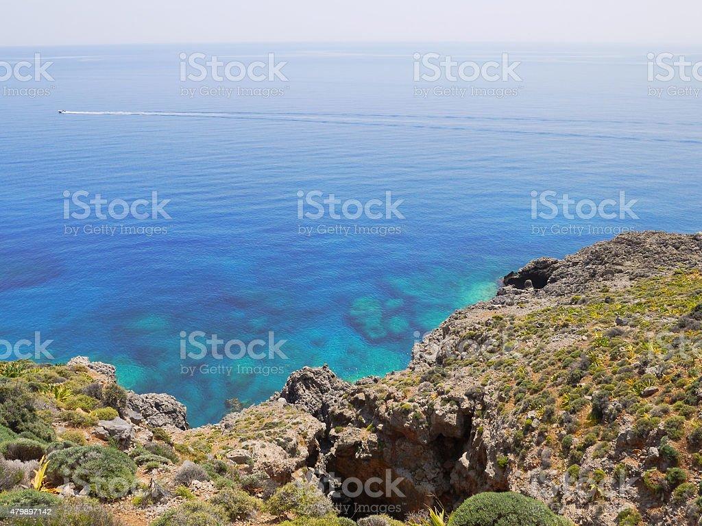 Boat far in the blue sea stock photo