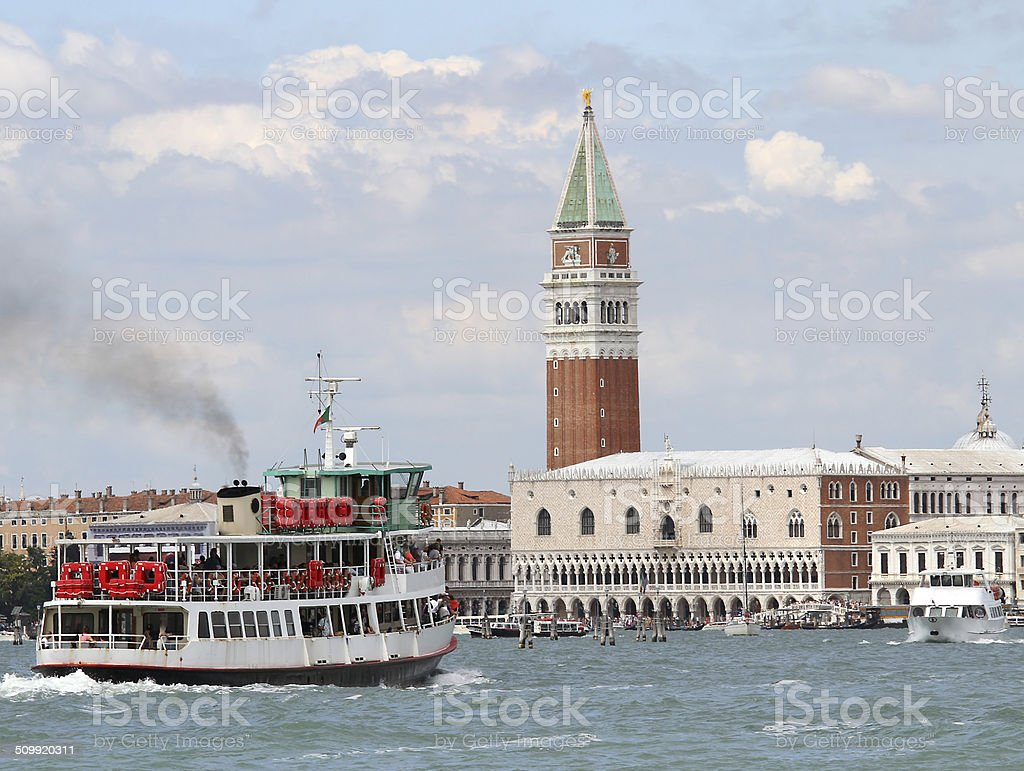 boat ferry for transporting passengers and tourists in venice stock photo