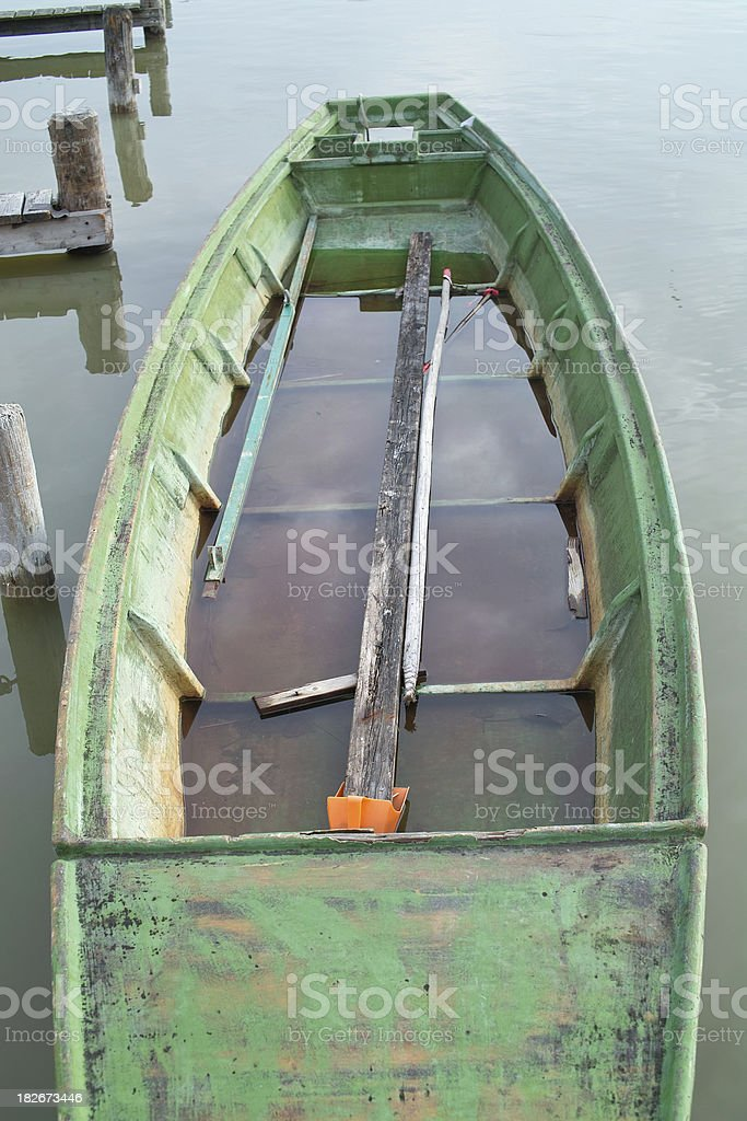 Boat filled with water in Marina royalty-free stock photo