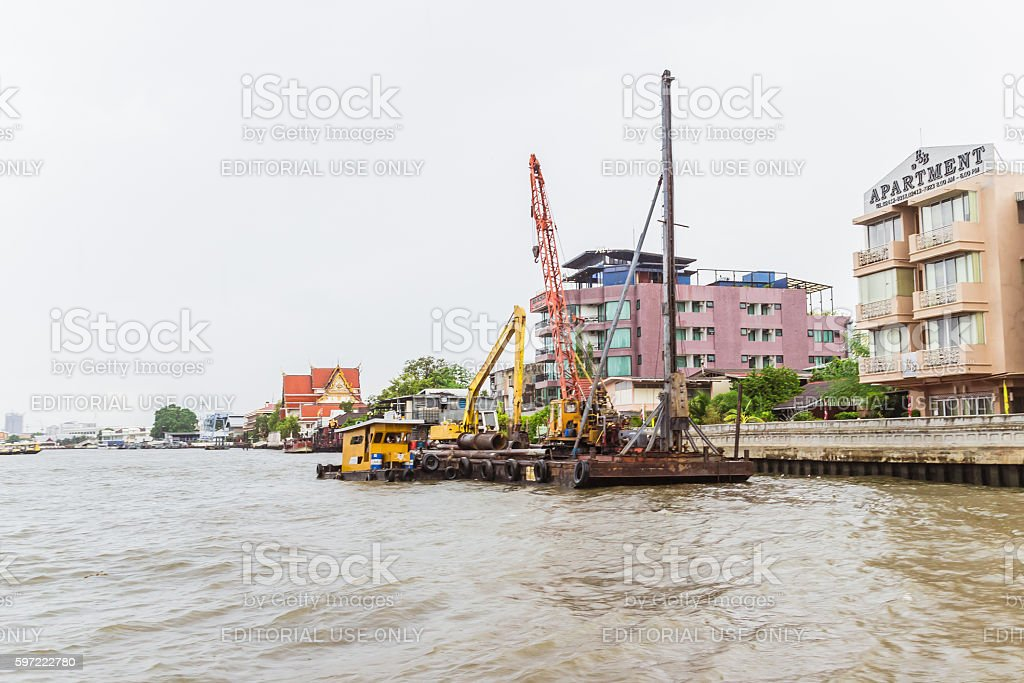 Boat for driving piles into ri stock photo
