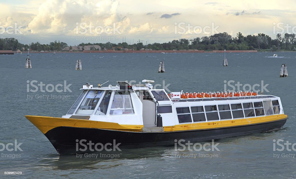 boat for transporting passengers and tourists in venice stock photo