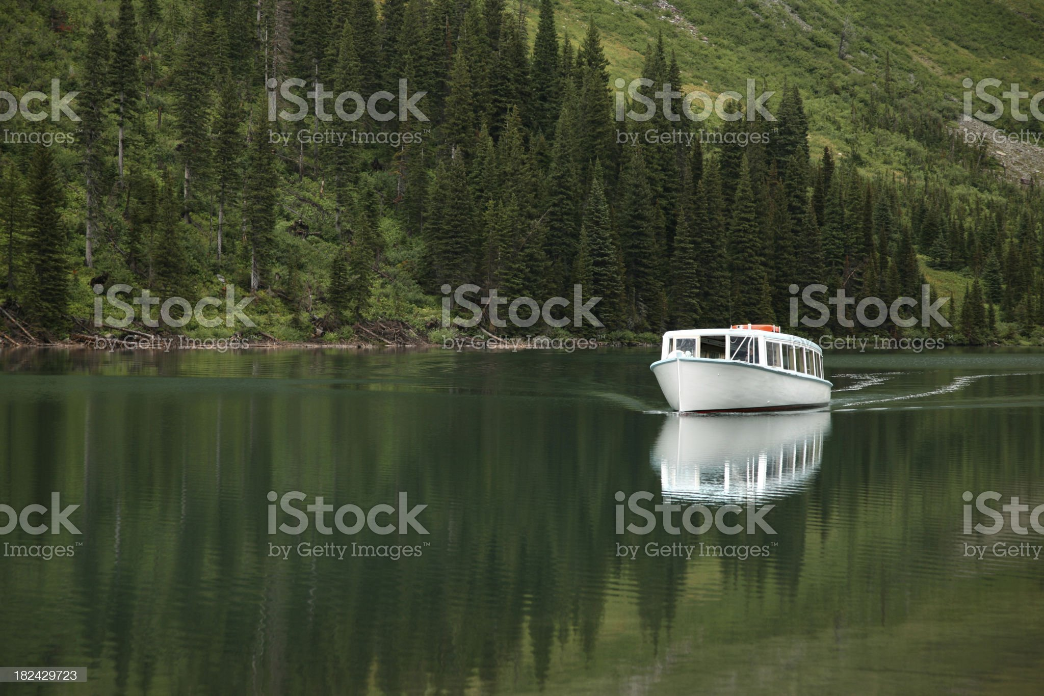 Boat Gliding through Tranquil Lake royalty-free stock photo