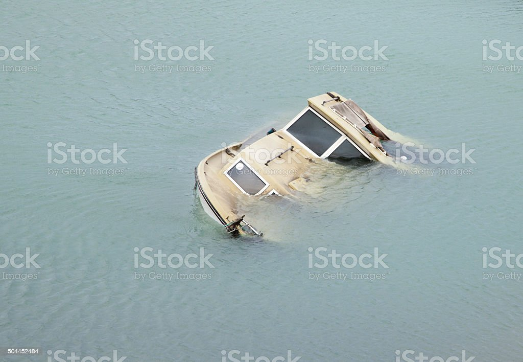 Boat going down stock photo