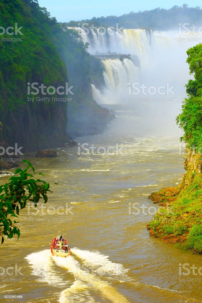 Boat going to Devil's Throat, impressive Iguacu Falls, Brazil rainforest stock photo
