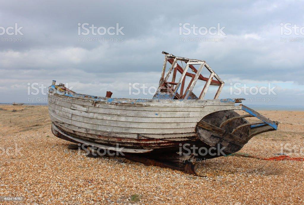 Boat graveyard and fishing huts at Dungeness, England stock photo