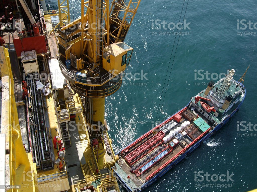 Boat handling on an oilrig stock photo
