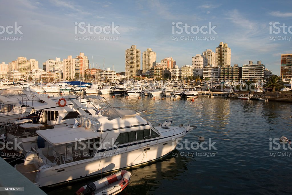 Boat harbor of Punta del Sol with skyline in background stock photo