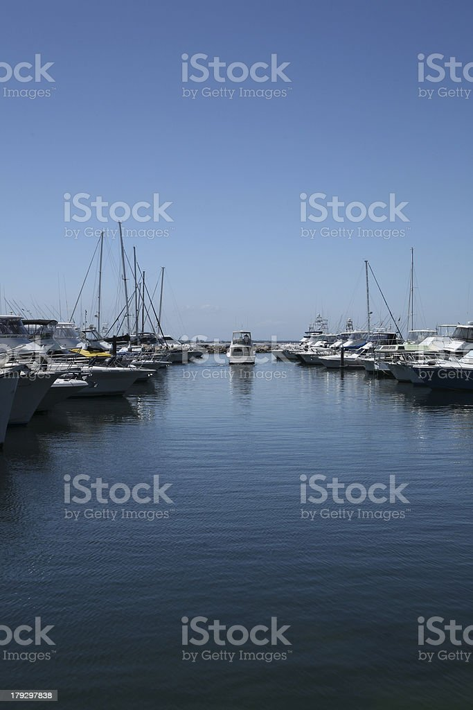 Boat heading out the harbour to sea royalty-free stock photo