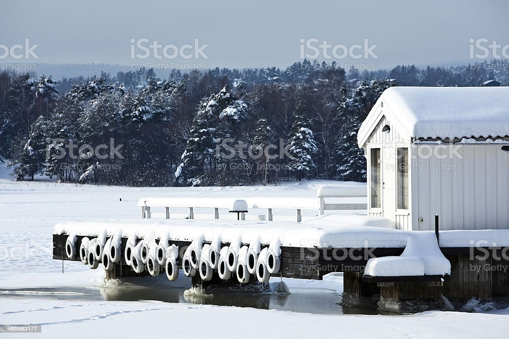 Boat house in a frozen harbor. royalty-free stock photo