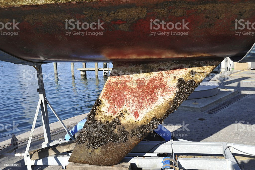 Boat hull in a dry dock for thorough cleaning underneath stock photo