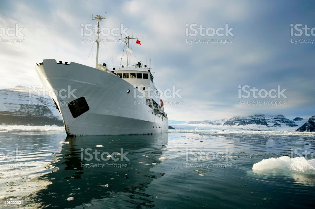 Boat in a fjord of greenland stock photo