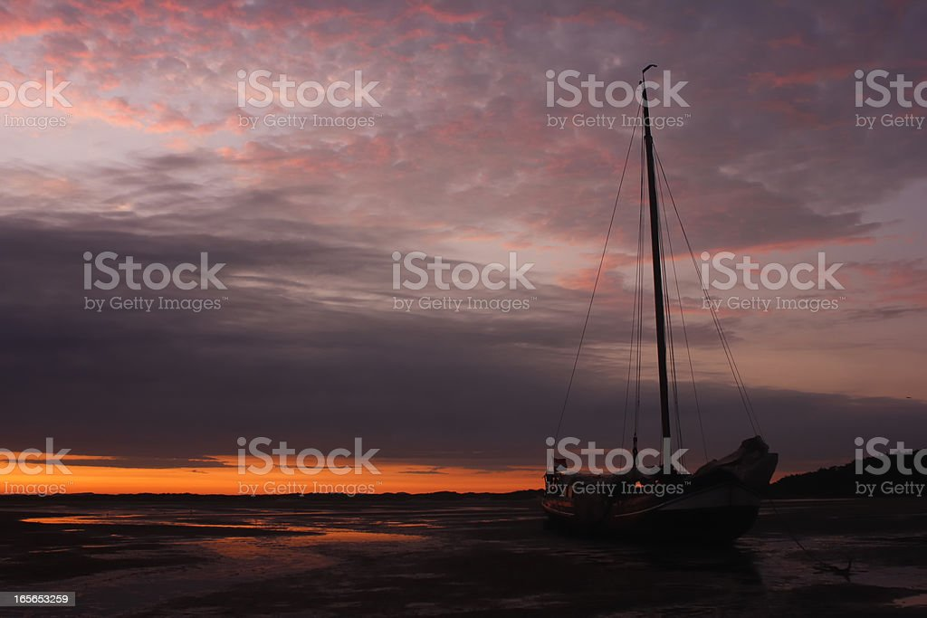 Boat in a sunset stock photo