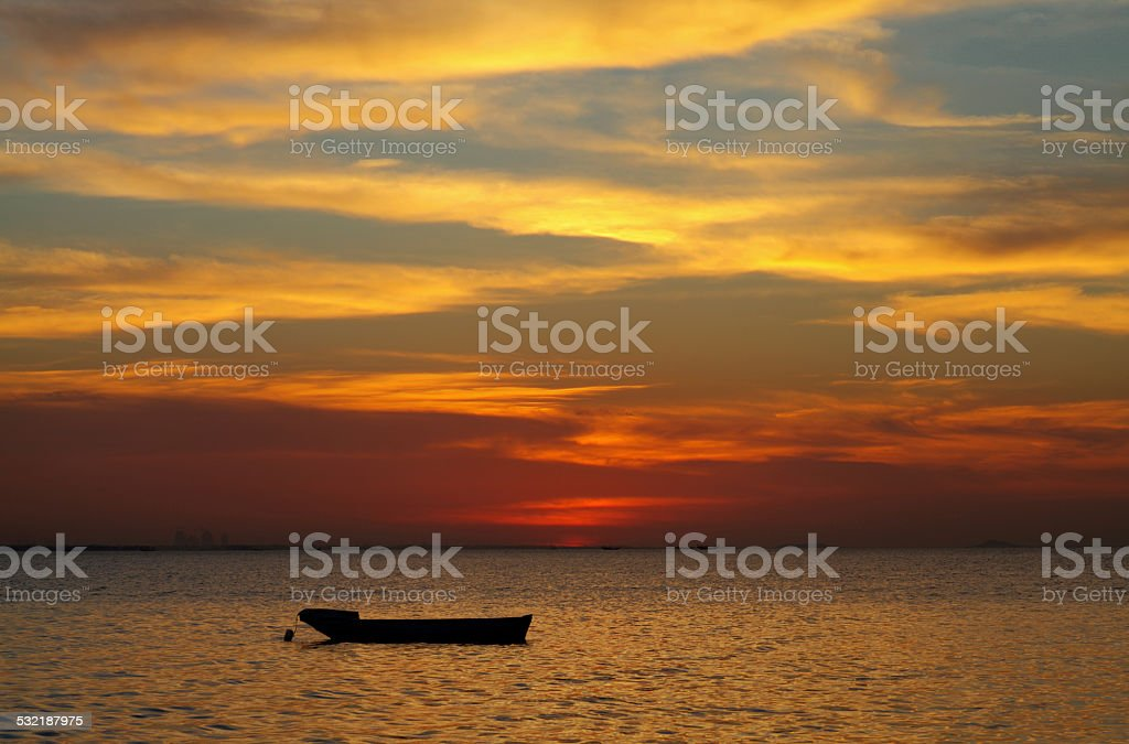 Boat in beautiful sunset, HDR photograph stock photo
