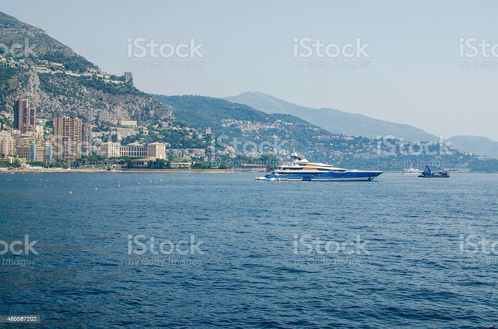 Boat in front of Monaco Monte Carlo harbour stock photo