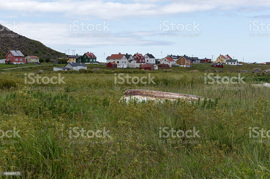 Boat in front of the village royalty-free stock photo
