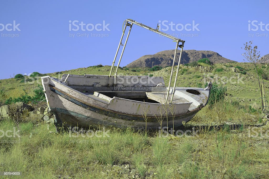 Boat in grass stock photo