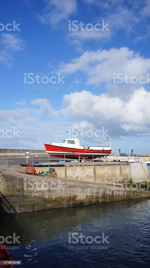 boat in harbour Northumberland stock photo