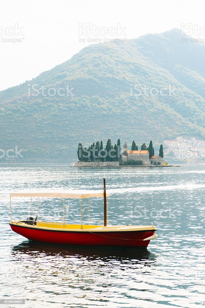 Boat in Kotor Bay stock photo