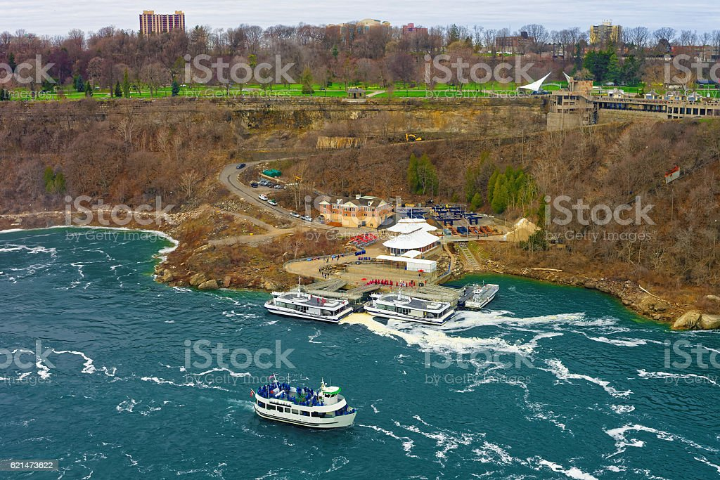 Boat in Niagara River and View of Ontario in Canada stock photo