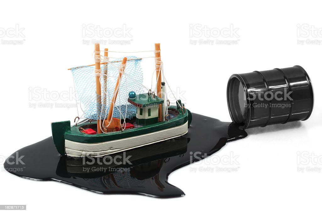 Boat in oil slick stock photo