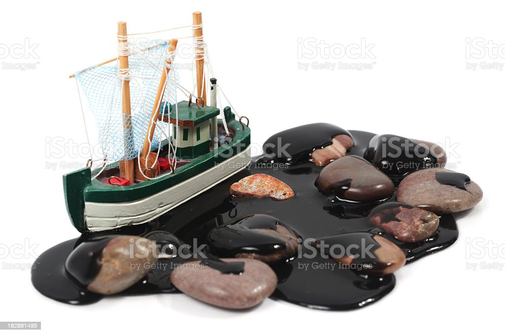 Boat in oil slick royalty-free stock photo