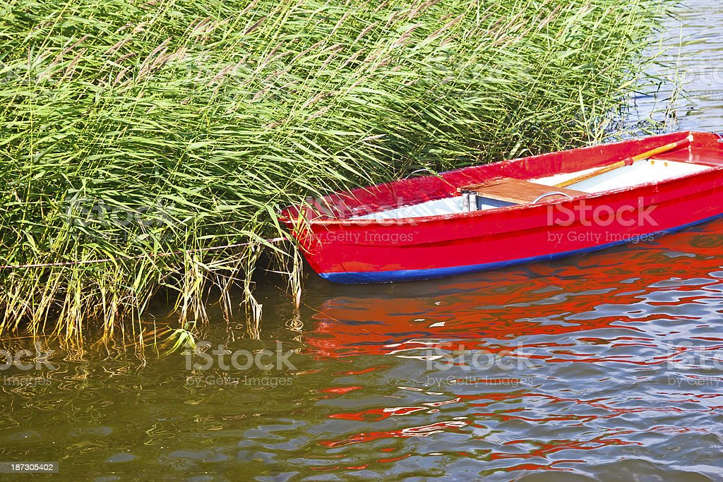 Boat in reeds royalty-free stock photo